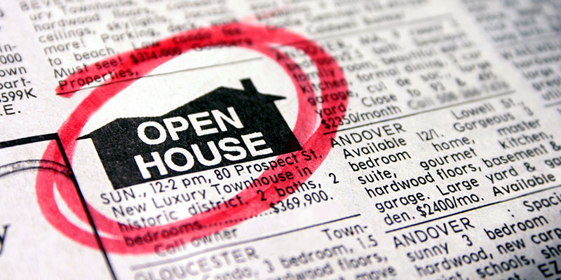 Newspaper displaying an open house ad