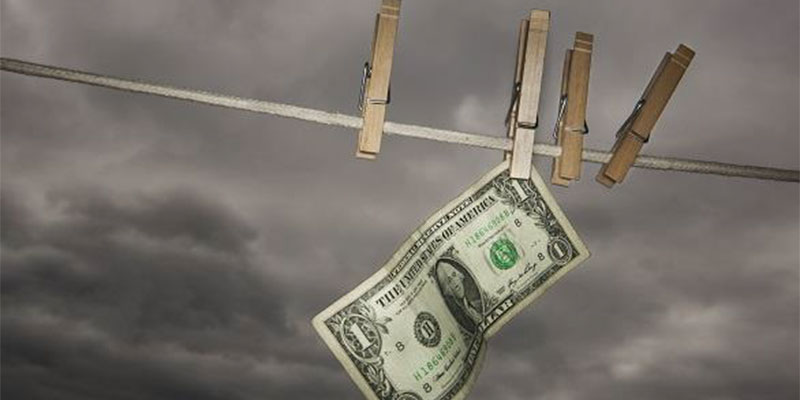 Dollar bill pinned to clothesline