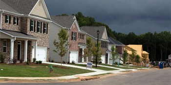 Small collection of new homes along a typical city street